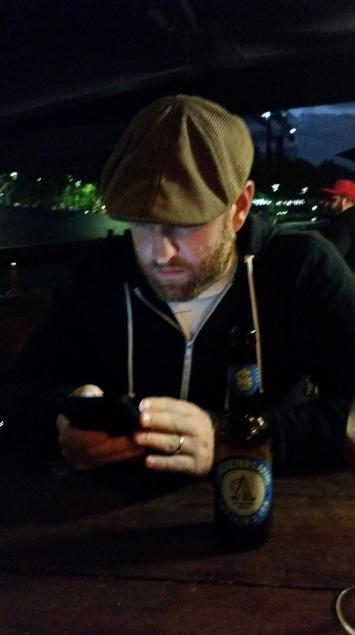 The Classic McGregor (phone, drink, hat on) by the Yarra