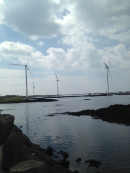 Jeju has a few windmills scattered across the island. These ones are offshore but when the tide is low, you can cross between some of them.